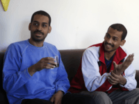 "Alexanda Amon Kotey, left, and El Shafee Elsheikh, who were allegedly among four British jihadis who made up a brutal Islamic State cell dubbed ""The Beatles,"" speak during an interview with The Associated Press at a security center in Kobani, Syria, Friday, March 30, 2018. The men said that their home country's revoking of their citizenship denies them fair trial. ""The Beatles"" terror cell is believed to have captured, tortured and killed hostages including American, British and Japanese journalists and aid workers. (AP Photo/Hussein Malla)"