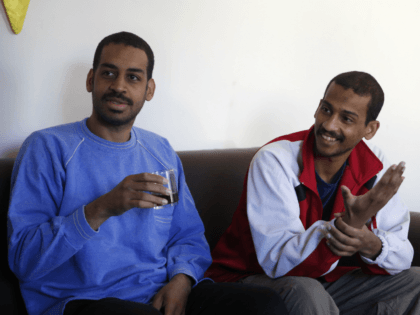 """Alexanda Amon Kotey, left, and El Shafee Elsheikh, who were allegedly among four British jihadis who made up a brutal Islamic State cell dubbed """"The Beatles,"""" speak during an interview with The Associated Press at a security center in Kobani, Syria, Friday, March 30, 2018. The men said that their …"""