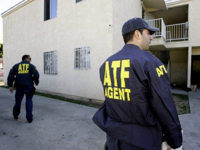 Alcohol, Tobacco and Firearms (ATF) officers inspect the grounds of an apartment building after tear gas was used during a raid in South Los Angeles Thursday, April 12, 2007. A two-year probe of the violent South Los Angeles street gang, the Neighborhood Crips, ended Thursday with 22 arrests, including one …