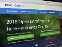 In this Dec. 15, 2017 photo, the HealthCare.gov website is photographed in Washington. A new tally by The Associated Press finds that nearly 11.8 million Americans have signed up for coverage this year under former President Barack Obama's health care law. That's only about 3 percent less than last year, …