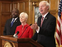 Gov. Asa Hutchinson speaks at a news conference Monday, March 5, 2018, at the state Capitol in Little Rock, Ark., with Daryl Bassett, the head of Arkansas' Department of Workforce Services, and Cindy Gillespie, the director of the state Department of Human Services. The federal Centers for Medicare and Medicaid …