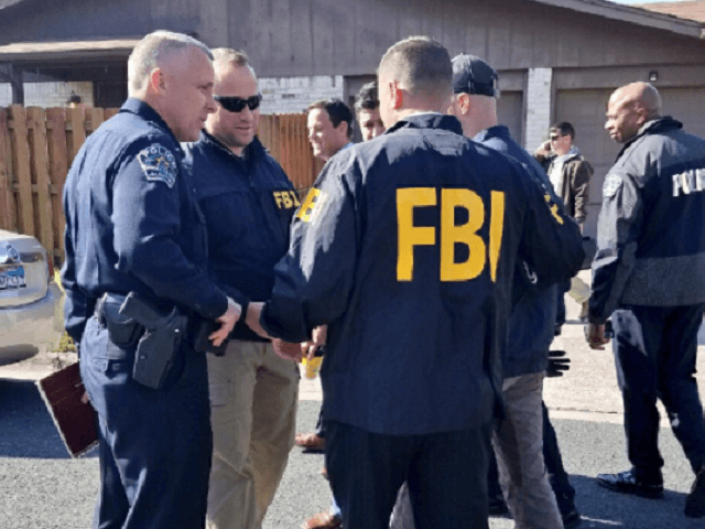 Austin police chief with FBI