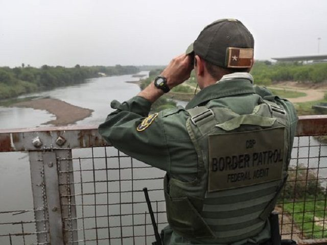 Border Patrol Agent in Laredo Patroling Rio Grande River - Getty Immages John Moore