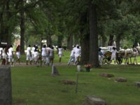 Followed by mourners, Antonio Brown and Amber Hailey accompany the casket of their 7-year-old son, Amari Brown, on a horse-drawn carriage at the Oakridge-Glen Oak cemetery in Hillside, Ill., on Saturday, July 11, 2015. Police say Amari was celebrating July 4 at his father's home on Chicago's West Side when …
