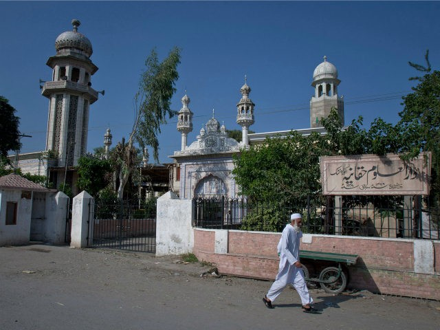In this Wednesday, Oct. 26, 2011 photo, a man walks past the Islamic seminary Darul Uloom Haqqania in Akora Khatak, Pakistan near Peshawar. Lecturing his students, the head of the school that spawned many of the insurgent leaders fighting in Afghanistan spoke of the need for continued fighting there. But …