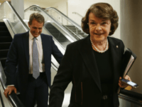U.S. Sen. Dianne Feinstein (D-CA) and Sen. Jeff Flake (R-AZ) leave after a vote on Loretta Lynch to become the next U.S. Attorney General April 23, 2015 on Capitol Hill in Washington, DC. The Senate has confirmed the nomination with a vote of 56 to 43. (Photo by Alex Wong/Getty Images)