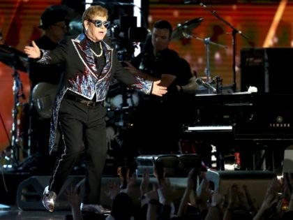 """Elton John performs """"Tiny Dancer"""" at the 60th annual Grammy Awards at Madison Square Garden on Sunday, Jan. 28, 2018, in New York. (Photo by Matt Sayles/Invision/AP)"""