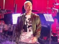 Recording artists Eminem performs onstage at the 2014 MTV Movie Awards at Nokia Theatre L.A. Live on April 13, 2014 in Los Angeles, California. (Photo by Christopher Polk/Getty Images for MTV)