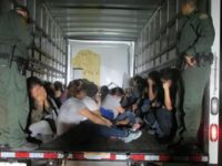 Migrants found being smuggled in truck.