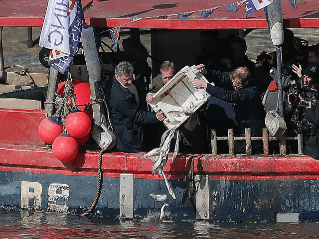 British conservative party member of parliament Jacob Rees-Mogg arrives to attend an event arranged by the pro-Brexit 'Fishing for Leave' group, where fishermen, and former UK Indepence Party (UKIP) Leader Nigel Farage (2L), threw fish into the River Thames from a boat as it sailed past Britain's Houses of Parliament …