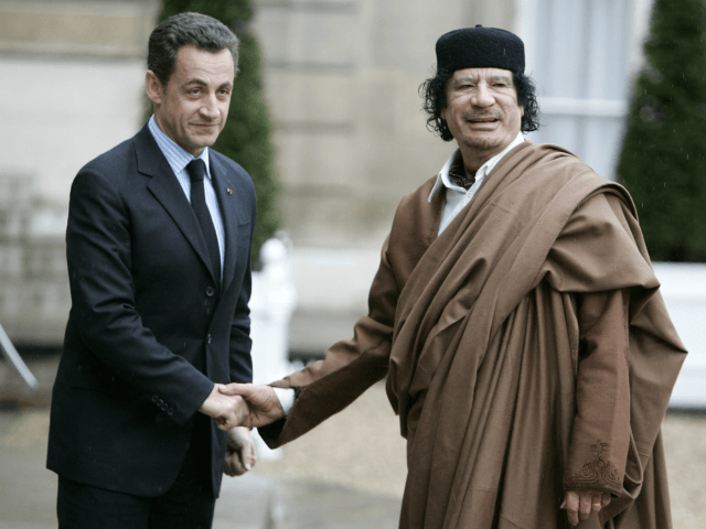 FILE - In this Dec. 10 2007 file photo, French President Nicolas Sarkozy, left, greets Libyan leader Col. Moammar Gadhafi upon his arrival at the Elysee Palace, in Paris. Former French President Nicolas Sarkozy was placed in custody on Tuesday March 20, 2018as part of an investigation that he received …
