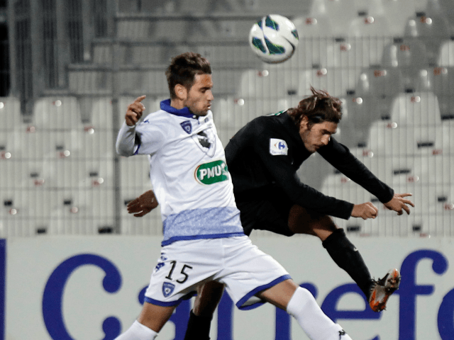 CA Bastia's Anthony Salis (R) vies with Bastia's French defender Gaetan Varenne (L) during the French Cup football match CA Bastia (CAB) vs Sporting Club de Bastia (SCB) at the Francois Coty stadium in Ajaccio, Corsica, on January 6, 2013. AFP PHOTO / PASCAL POCHARD-CASABIANCA (Photo credit should read PASCAL …
