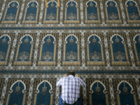 TO GO WITH AFP STORY BY NINA LARSON A Muslim worshipper prays in a mosque in the southern Swedish city of Malmoe on October 27, 2010. Panic has spread in the southern Swedish city since police announced last week they were investigating whether a lone shooter with racist motives was …