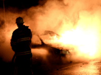 Firemen extinguish a burning car in Kista after youths rioted in few differant suburbs around Stockholm on May 21, 2013. Youths in the immigrant-heavy Stockholm suburb of Husby torched cars and threw rocks at police, in riots believed to be linked to the deadly police shooting of a local resident. …