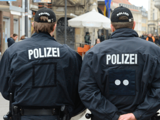 Police officers secure an area in the centre of Luebeck, northern Germany, where G7 foreign ministers will be received on April 14, 2015. The foreign ministers meet to discuss key global political and security issues ahead of a G7 summit to take place in June 2015 in southern Germany. The …