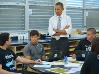 US President Barack Obama chats with students while visiting a classroom at Coral Reef High School in Miami, Florida on March 7, 2014. AFP PHOTO/Mandel NGAN (Photo credit should read MANDEL NGAN/AFP/Getty Images)