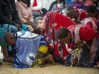 Twelve-year-old South African Kyle Todd (C) performs during his initiation ceremony to become a Sangoma or traditional healer at a traditional healer school on November 14, 2015, in Pretoria, South Africa. South African traditional healers are practitioners of traditional African medicine in Southern Africa. They fulfill different social and political …