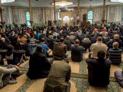 Muslim cleric Mouhameth Galaye (C) speaks ahead of Friday Prayers at the Grand Mosque in Brussels on Match 25, 2016, as Muslims gathered for the first Friday prayers in the wake of the suicide attacks at Brussels airport and a metro station that left 31 people dead and 300 wounded …