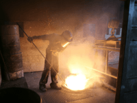 ROTHERHAM, ENGLAND - APRIL 18: A worker tends to the furnace producing ferrotitanium during a visit to Tivac Alloys by UKIP leader Nigel Farage to see first hand how the global steel crisis is affecting small businesses on April 18, 2016 in Rotherham, England. Candidates are canvassing for votes in the Brightside and Hillsborough by-election taking place on 5 May 2016. (Photo by Christopher Furlong/Getty Images)