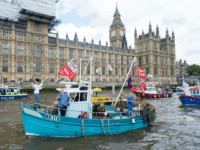 LONDON, ENGLAND - JUNE 15: Pro 'Leave' boats form a flotilla as Nigel Farage, leader of the UK Independence Party shows his support for the 'Leave' campaign for the upcoming EU Referendum aboard a boat on the River Thames on June 15, 2016 in London, England. Nigel Farage, leader of …