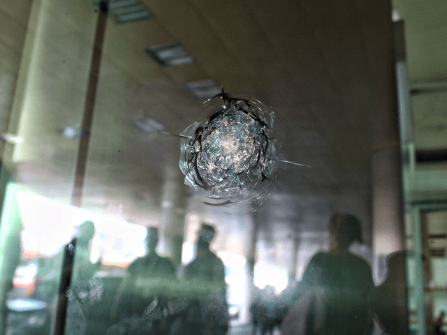 ISTANBUL, TURKEY - JUNE 29: Reflections are cast on the glass where bullet holes remain at Turkey's largest airport, Istanbul Ataturk, Turkey, June 29, 2016, Turkey. Three suicide bombers opened fire before blowing themselves up at the entrance to the main international airport in Istanbul yesterday, killing at least 36 …
