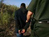 YUMA, AZ - MARCH 17: U.S. Customs and Border Protection border patrol agent Ben Vik apprehends a suspected illegal immigrant on the California side of the Colorado River on March 17, 2006 near Yuma, Arizona. As Congress begins a new battle over immigration policy, U.S. Customs and Border Protection (CBP) …