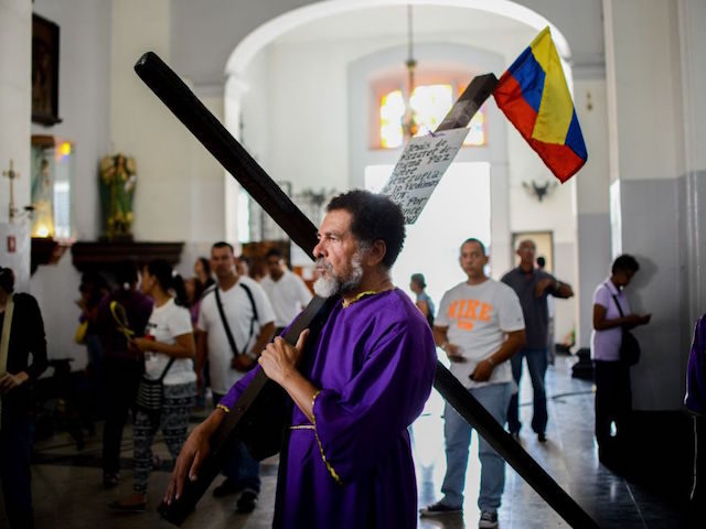 A Catholic faithful visits Santa Teresa basilica in Caracas during the celebration of the Nazarene of Saint Paul, part of the Holy Week festivities, on April 12, 2017. / AFP PHOTO / FEDERICO PARRA (Photo credit should read FEDERICO PARRA/AFP/Getty Images)