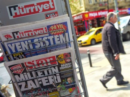 """This picture taken in Istanbul on April 17, 2017, shows the front pages of Turkish newspapers bearing headlines a day after Turkey's referendum : Hurriyet (top) bearing a headline which translates as """"New System"""" and Star bearing a headline which translates as """" Victory of people"""". The deputy leader of …"""