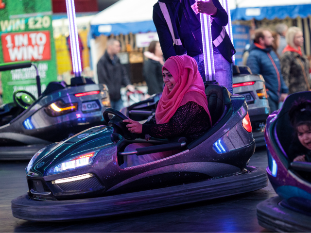 NOTTINGHAM, ENGLAND - OCTOBER 07: Visitors ride bumper cars at the Nottingham Goose Fair in the Forest Recreation Ground on October 7, 2017 in Nottingham, England. The annual goose fair hosts over 500 attractions for thrill seekers including fun fair classics such as bumper cars, carousels and helter-skelters. The fair is thought to be over 700 years old and its name comes from its origins as a market in the forest grounds where thousands of geese were sold each year. (Photo by Jack Taylor/Getty Images)
