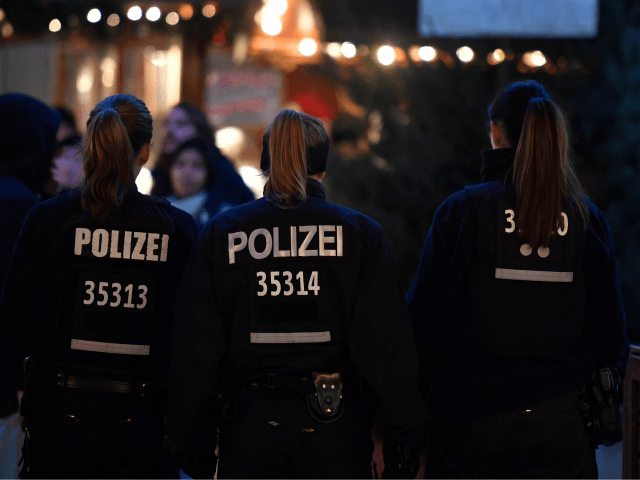 Policewomen patrol at the Christmas market at Breitscheidplatz near the Kaiser-Wilhelm-Gedaechtniskirche (Kaiser Wilhelm Memorial Church) one day ahead the anniversary of last year's deadly truck attack in Berlin, on December 18, 2017. Germany commemorates on December 19, 2017 victims of last year's devastating Christmas market attack in Berlin that claimed …