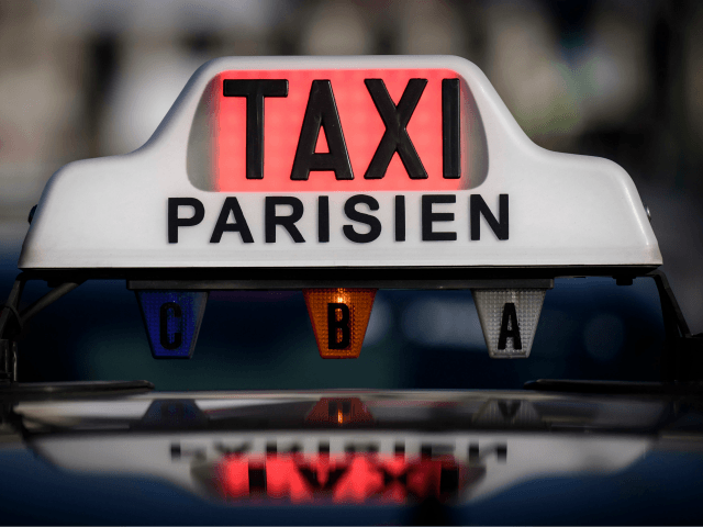 A taxi sign is illuminated in red to signify it is not available for hire during a protest by licensed taxi drivers in Paris on January 17, 2018, to ask the authorities for the compliance and enforcement of legislation concerning VTC drivers (private hire drivers) operating in the French capital. …