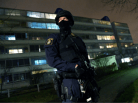 An armed police officer stands guard after an object exploded next to a police station in Rosengard in Malmo, Sweden on January 17, 2018. / AFP PHOTO / TT News Agency / Johan NILSSON / Sweden OUT (Photo credit should read JOHAN NILSSON/AFP/Getty Images)