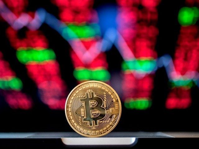 "A picture taken on February 6, 2018 shows a visual representation of the digital crypto-currency Bitcoin, at the ""Bitcoin Change"" shop in the Israeli city of Tel Aviv. / AFP PHOTO / JACK GUEZ (Photo credit should read JACK GUEZ/AFP/Getty Images)"