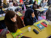 HALLE, GERMANY - FEBRUARY 14: Muslim women from Syria take part in a German lesson in the Muslim cultural center and mosque as Aydan Ozoguz (not pictured), German Federal Commissioner for Immigration, Refugees and Integration visits the center and mosque following a recent attack on February 14, 2018 in Halle an der Saale, Germany. Shots possibly fired with an air gun from a nearby building injured a mosque member earlier this month, only a week after a similar incident. The center has been the target of attacks since 2015 in a city that struggles with right-wing extremism, which has become more virulent since over a million mostly Muslim refugees and migrants came to Germany in 2015-2016. (Photo by Jens Schlueter/Getty Images)