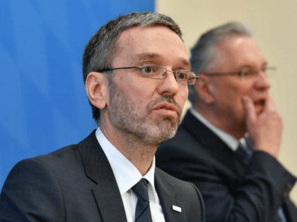 Austrian Interior Minister and member of the Freedom Party (FPOe), Herbert Kickl (L), and Bavaria's Interior Minister and member of the Christian Social Union (CSU) party, Joachim Herrmann, give a joint presser in Munich on February 15, 2018. / AFP PHOTO / APA / BARBARA GINDL / Austria OUT (Photo …