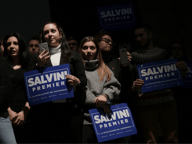 Supporters of the Northern League leader Matteo Salvini hold a banner during an elections rally organized by Lega (Northern League) in Teatro Nuovo in Turin on February 28, 2018. / AFP PHOTO / MARCO BERTORELLO (Photo credit should read MARCO BERTORELLO/AFP/Getty Images)