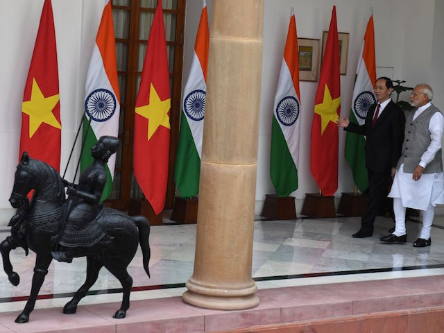 India's Prime Minister Narendra Modi (R) walks with Vietnam's President Tran Dai Quang prior to a meeting and agreement signing in New Delhi on March 3, 2018. / AFP PHOTO / PRAKASH SINGH (Photo credit should read PRAKASH SINGH/AFP/Getty Images)