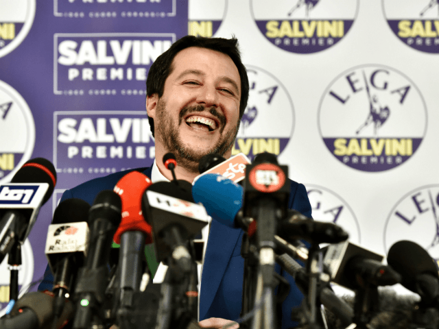 Lega far right party leader Matteo Salvini laughs during a press conference held at the Lega headquarter in Milan on March 5, 2018 ahead of the Italy's general election results. A surge for populist and far-right parties in Italy's weekend election could result in a hung parliament with a right-wing …