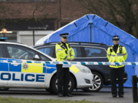 SALISBURY, ENGLAND - MARCH 06: Police officers man a cordon near a forensic tent (not pictured) where a man and woman had been found unconscious two days previosly, on March 6, 2018 in Salisbury, England. The man is believed to be Sergei Skripal, 66, who was granted refuge in the …
