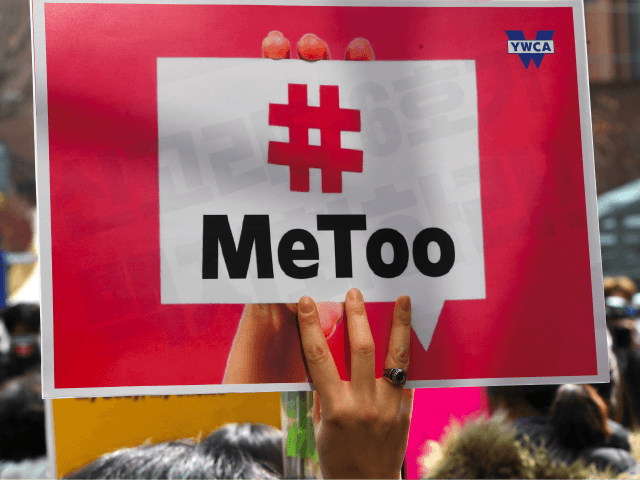 A South Korean demonstrator holds a banner during a rally to mark International Women's Day as part of the country's #MeToo movement in Seoul on March 8, 2018. The #MeToo movement has gradually gained ground in South Korea, which remains socially conservative and patriarchal in many respects despite its economic …