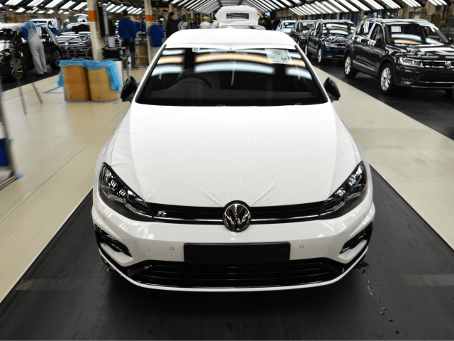 WOLFSBURG, GERMANY - MARCH 08: The front of a Volkswagen Golf car is displayed at an assembly line at the Volkswagen factory on March 8, 2018 in Wolfsburg, Germany. U.S. President Donald Trump has threatened to impose tariffs on imports of cars made in Europe in an ongoing and escalating …
