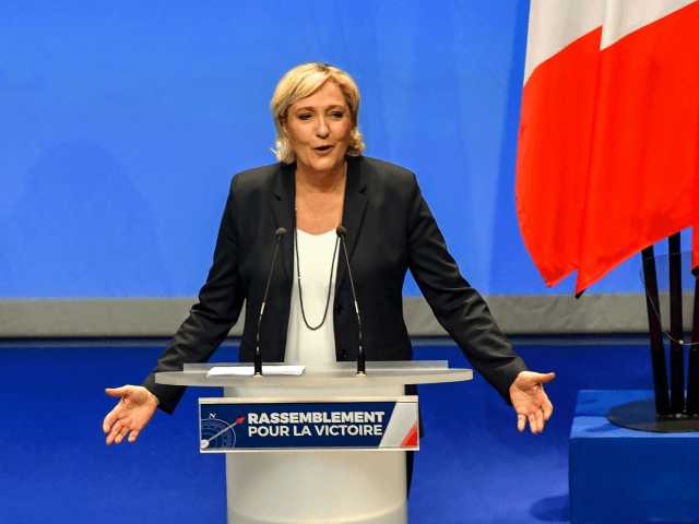 French far-right party Front National president Marine Le Pen speaks during her party's congress on March 11, 2018 in Lille, north of France, after being re-elected for a third term as leader. The 49-year-old is expected to unveil the party's new identity, burying the National Front (FN) name that has …