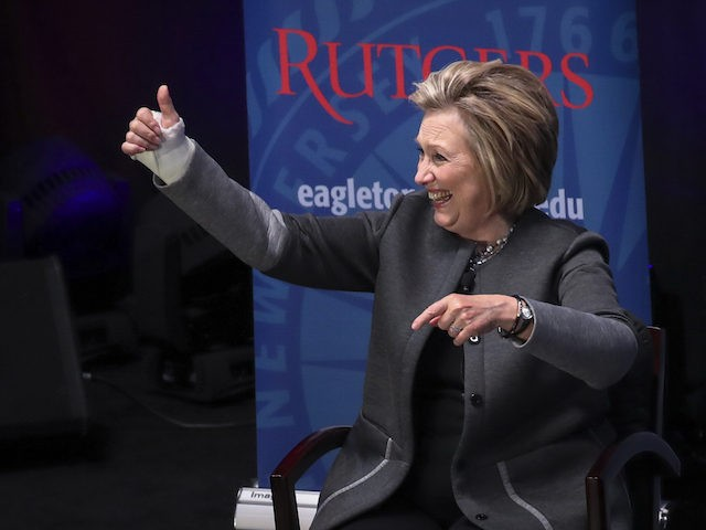 PISCATAWAY, NEW JERSEY - MARCH 29: Former Secretary of State and former First Lady Hillary Clinton gives the thumbs up after speaking at Rutgers University, March 29, 2018 in Piscataway, New Jersey. Clinton is being paid $25,000 for her appearance. The money will come from a university endowment fund, according …