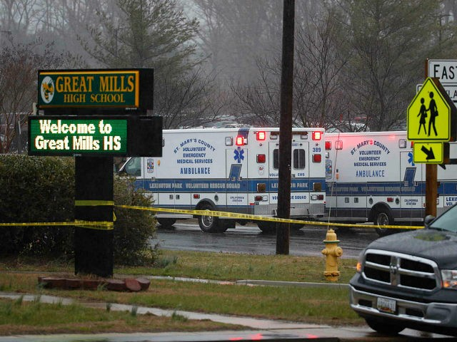 Deputies, federal agents and rescue personnel, converge on Great Mills High School, the scene of a shooting, Tuesday morning, March 20, 2018 in Great Mills, Md. (AP Photo/Alex Brandon )