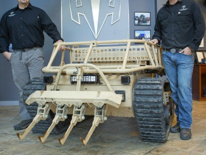 WATERBORO, ME - DECEMBER 20: Howe and Howe Technologies has secured a contract to build twenty RS2H1 robots for the U.S. military. Michael Howe, left, and Geoffrey pose with the robot vehicle at their business in Waterboro. (Photo by Derek Davis/Staff photographer)