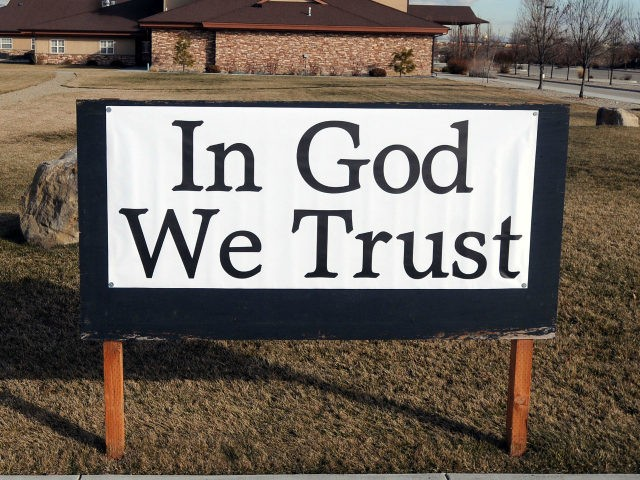 """A sign that reads """"In God We Trust"""" is pictured outside the Central Valley Baptist Church on Tuesday, Feb. 9, 2010 in Meridian, Idaho. Laura Silsby is among five members of the Central Valley Baptist church congregation being held in a Haitian jail on charges of kidnapping. A closer look at Silsby's life shows that the adoption fiasco follows a predictable pattern surrounding the 40-year-old businesswoman and mother of two: Her big promises and big dreams often give way to questionable actions and frequent legal action. (AP Photo/Charlie Litchfield)"""