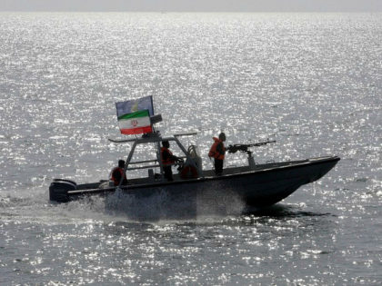 FILE - In this July 2, 2012 file photo, an Iranian Revolutionary Guard speedboat escorts a passenger ship, near the spot where an Iranian airliner was shot down by a U.S. warship 24 years ago killing 290 passengers in Persian Gulf. While U.S. President Donald Trump angered Iran with his …