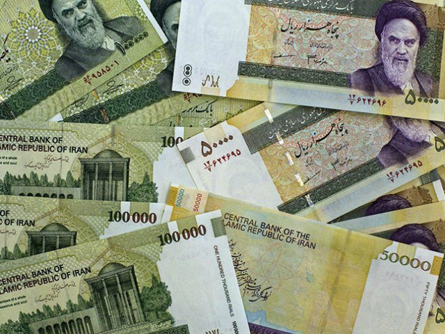 A picture taken on April 11, 2011 shows Iran's biggest denomination currencies, 100000 Rials (8.9 US dollars) and 50000 Rials (4.45 US dollars) in Tehran. Iran plans to slash four zeroes from the national currency in 'one or two years', seeking parity between its rial and the US dollar, Central …