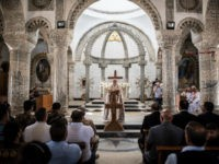 Iraqi Syriac Christian priest Charbel Aesso leads an easter service at Saint John's Church (Mar Yohanna) in the nearly deserted predominantly Christian Iraqi town of Qaraqosh on April 16, 2017 near Mosul, Iraq. Qaraqosh was retaken by Iraqi forces in 2016 during the offensive to capture the nearby city of …