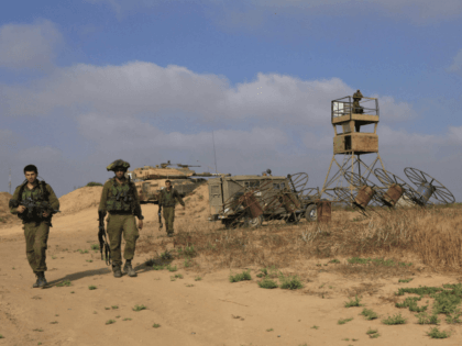 Israeli soldiers patrol near the Israeli Gaza border, Monday June 08, 2009. Israeli troops battled Palestinian gunmen early Monday in a flare-up of violence along the tense frontier between Israel and Hamas-controlled Gaza. A group of around 10 gunmen were trying to cross the border fence into Israel when they …